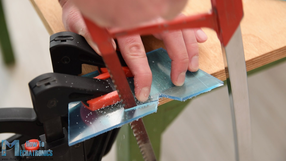 Shaping acrylic using a metal hand saw