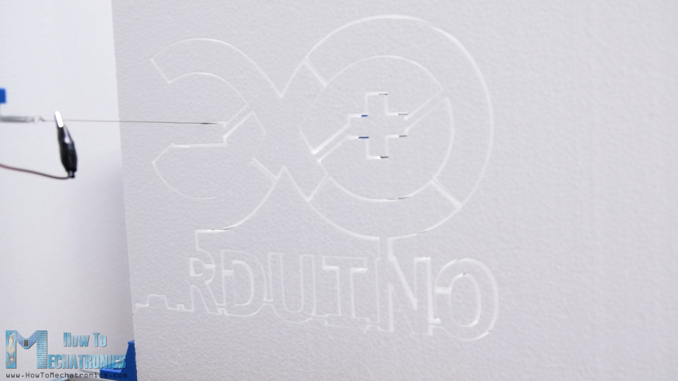 Arduino Logo being shaped on an Arduino CNC foam cutting machine