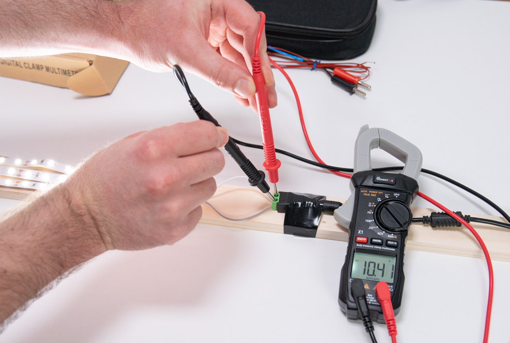 Measuring voltage with a clamp meter