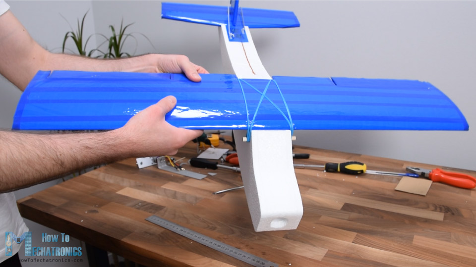 Securing the RC Plane wing to the fuselage with rubber bands