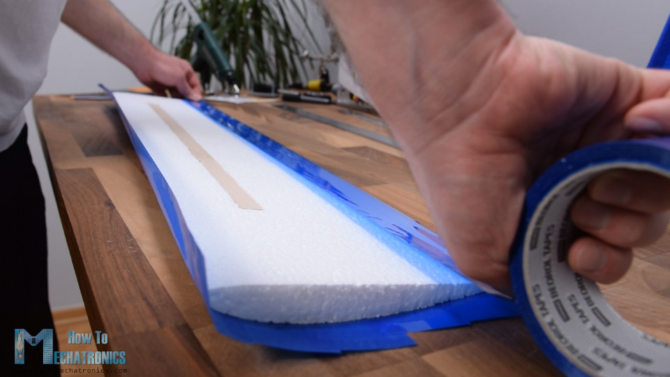 Wrapping the Arduino RC Airplane wing with a packing tape