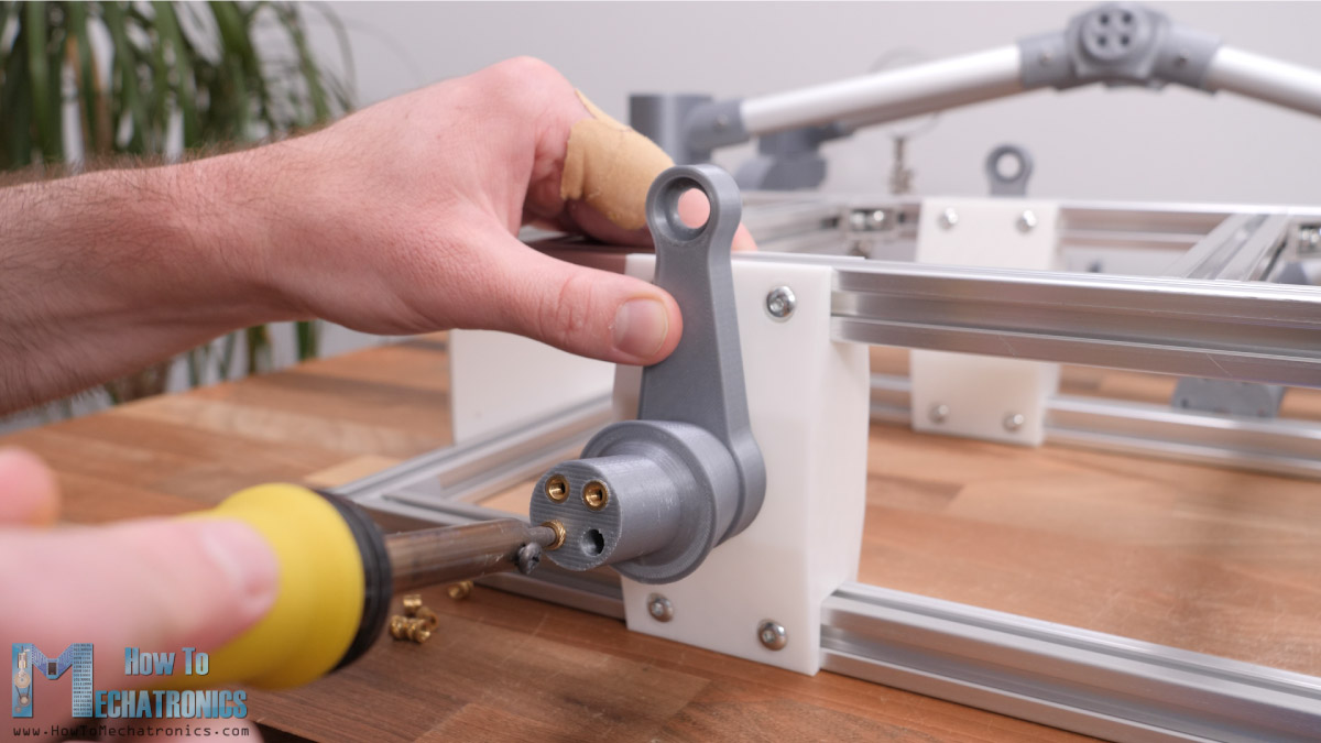 Inserting brass threaded inserts into a 3D printed part with a soldering iron